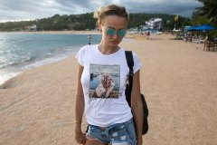 Beautiful Young Woman In A White T-shirt On The Beach. Mock-up.